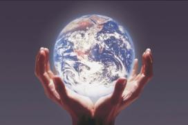 2 hands holding up backlit globe of planet earth